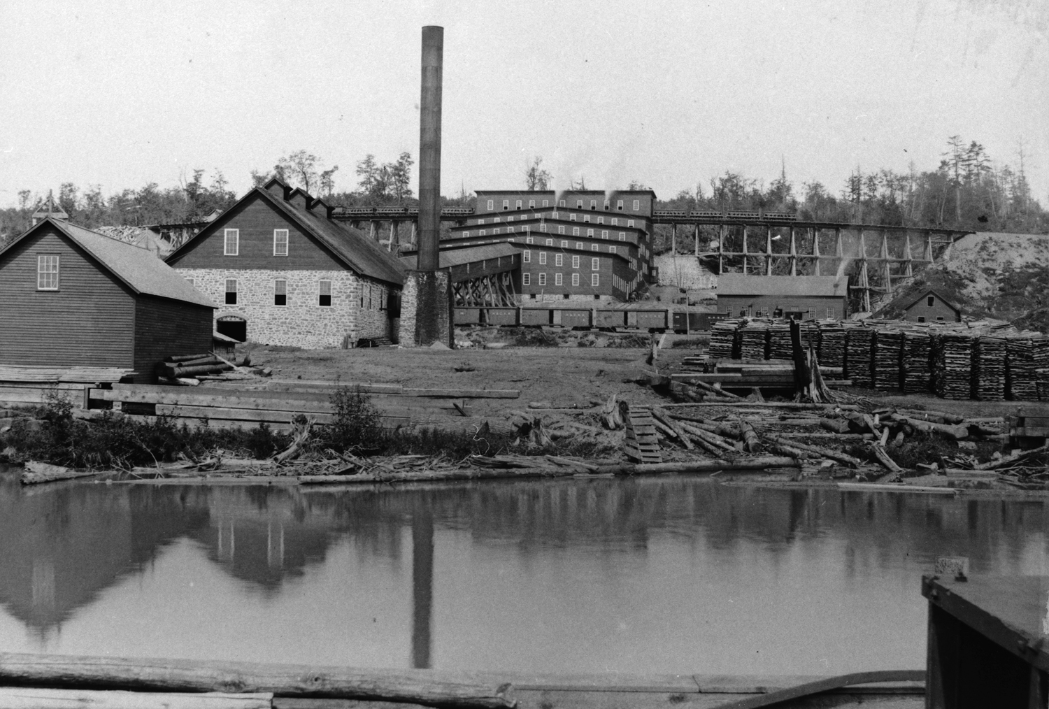 No 1 Mill circa 1890 as viewed from the lake. Note the trestles  entering the building from each side.
