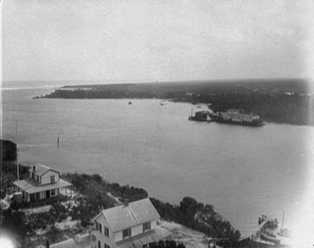 View from the lighthouse at Jupiter Inlet. The Jupiter dock and a ship docked can be seen across the bay.