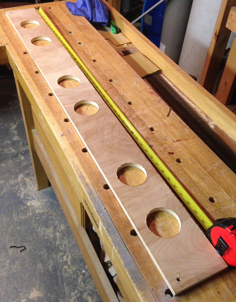 Cut holes in stringers before assembly. Holes lighten the frame and allow for wiring.
