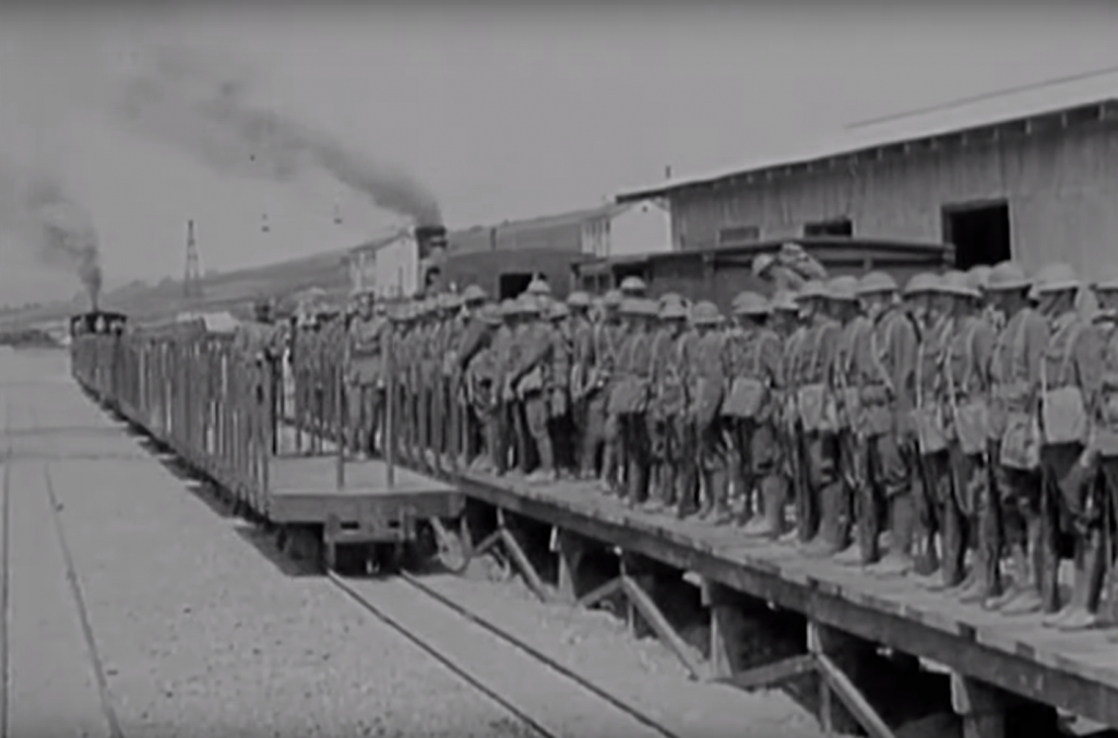 Troops are transferred from broad gauge to the 60cm narrow gauge light railway. Notice the warehouses and larger broad gauge train behind the soldiers.